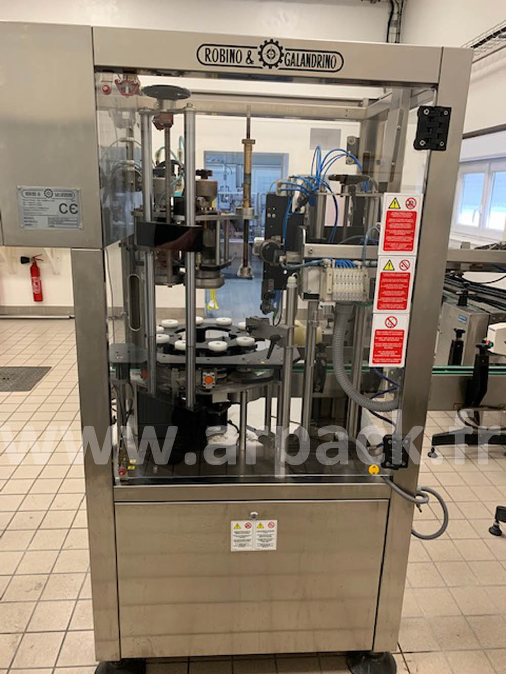 Champagne bottle capsuling machine